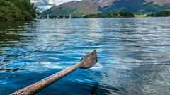 rowing on the lake - stock photo
