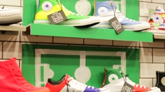 Sneakers in the Converse store. - stock footage