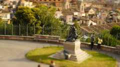 Tourists in Rome walk past statue timelapse tilt shift 4K Stock Footage