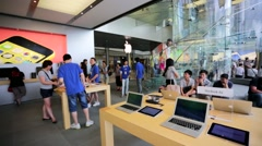Customers inside Apple store. - stock footage