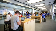 Customers inside Apple store - stock footage