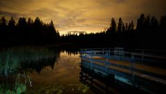 Night time lapse lake distant light fast moving clouds 4K Stock Footage