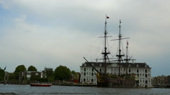 Old sailing ship in Amsterdam at maritime museum amsterdam Stock Footage