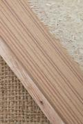 Rice grain and wooden background texture Stock Photos