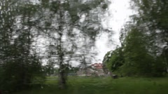 Driving past a school on a rainy day Stock Footage