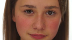 Closeup face portrait of a pretty young girl Stock Footage