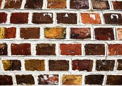 old brick wall background with high saturation. - stock photo