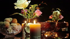 Candles, candy, flowers on the table Stock Footage
