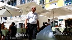 Daily activity on terrace restaurant in Lisbon Stock Footage