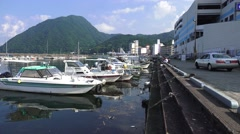 Seaside Marina Next To Costal Mountain In Beppu Japan 02 4K Stock Footage