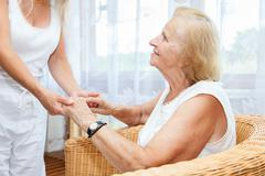 providing care for elderly - stock photo