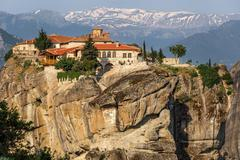 kalampaka town and rock with holy trinity monastery on a top, meteora, greece - stock photo