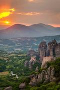 sunset light over meteora monasteries, greece - stock photo