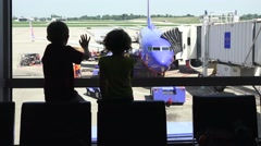 Waving children, airport terminal silhouette Stock Footage