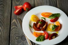 tomato salad with basil - stock photo