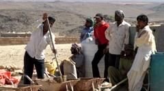 Salalah Arabia Orient Oman sultanate 008 Omani workers make cement for ruins Stock Footage