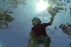 Boy swimming in the pool, steadycam shot, slow motion shot Stock Footage