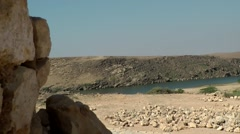 Stock Video Footage of Salalah Arabia Orient Oman sultanate 012 river in desert behind ruin stones