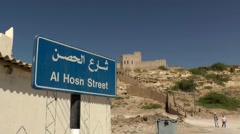 Salalah Arabia Orient Oman sultanate 015 street sign and museum on hill in Taqa Stock Footage