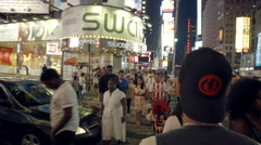 Times Square Night Crowded People Walking Religious Jews Yarmulka 4K NYC - stock footage