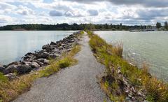 breakwater, path and sea - stock photo