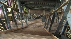 High angle - look down staircase + pan interior watchtower Stock Footage