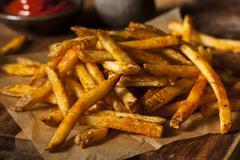 Cajun seasoned french fries Stock Photos