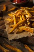 Cajun seasoned french fries Stock Photos