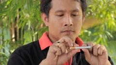 Man breaks a cigarette. Stock Footage