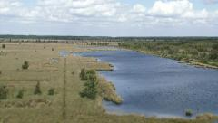 High angle view from watchtower at raised bog landscape + pan peat lake Stock Footage