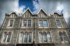 Victorian slate stone mansion Stock Photos