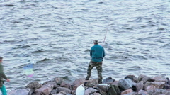 Fisherman fishing on the Gulf of Finland Stock Footage
