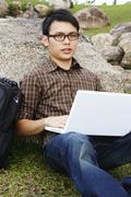 Stock Photo of young man with laptop