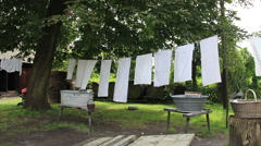 Laundry hanging on clothesline. Old, vintage lusatian farm Stock Footage