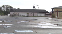 Urban decay industrial landscape potholes and structures Stock Footage