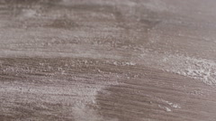 Scattered dry flour on a kitchen counter top Stock Footage