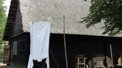 Retro, farm style shirt hanging to dry on a rope Stock Footage