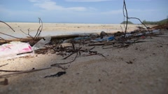 Closeup Beach Pollution. Garbage on the Beach. Slow Motion. Stock Footage