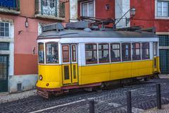 vintage yellow tram, symbol of lisbon, portugal - stock photo