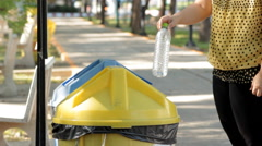 Putting plastic bottles in recycle container. Stock Footage