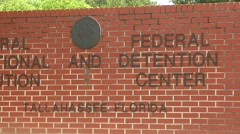 Prison, Federal, CU sign ZO reveal Tallahassee, Florida Stock Footage