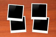 Stock Photo of blank picture frames on wooden table