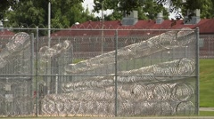 Prison, Federal. large razor coils intersecting corner Stock Footage