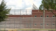 Stock Video Footage of Prison, Federal, three tiers razor wire & building