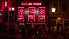 Moulin Rouge at Red Light district Amsterdam - stock footage