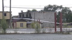 Urban decay industrial landscape cinderblock structures Stock Footage