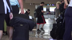 airport terminal traffic, ticket agent, - stock footage