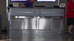 Airport terminal traffic,ticket upgrade counter Stock Footage