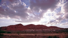 Clouds over red cliffs time lapse Stock Footage