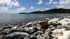 Waves wash over rocks in the virgin islands Stock Footage